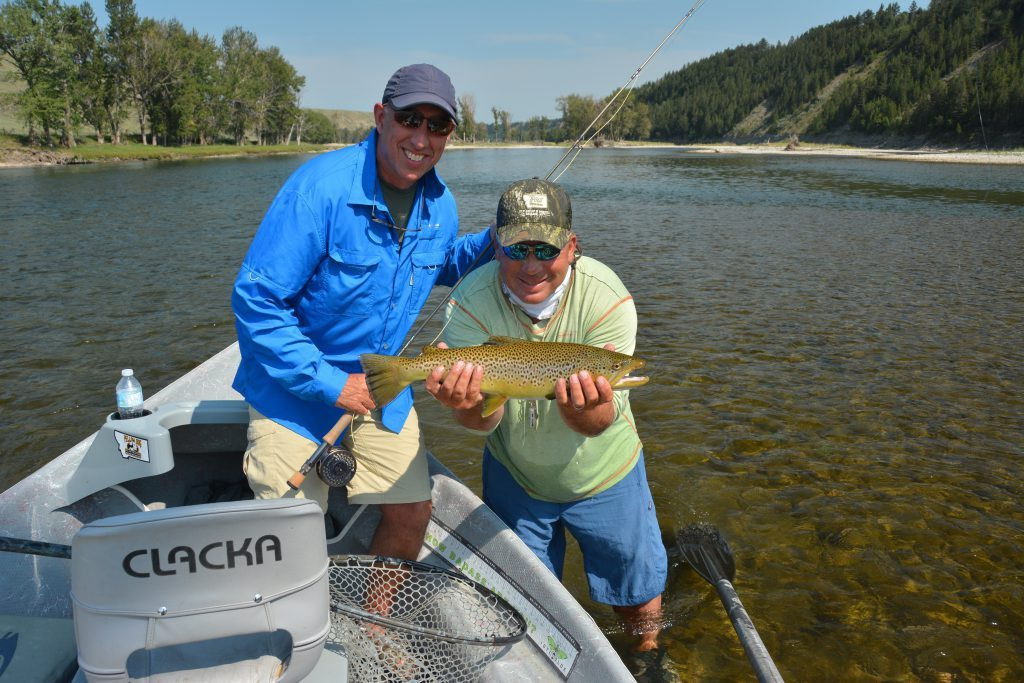 Outfitter and Guide Dave Brown with a happy Client and a 24 inch Bow River Brown Trout